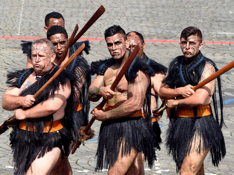 Maori soldiers take part in the annual Bastille Day military parade on the Place de la Concorde in Paris on July 14, 2016. France holds annual Bastille Day military parade with troops from Australia and New Zealand as special guests among the 3,000 soldiers who will march up the Champs Elysees avenue. They will be accompanied by 200 vehicles with 85 aircraft flying overhead. / AFP PHOTO / DOMINIQUE FAGET
